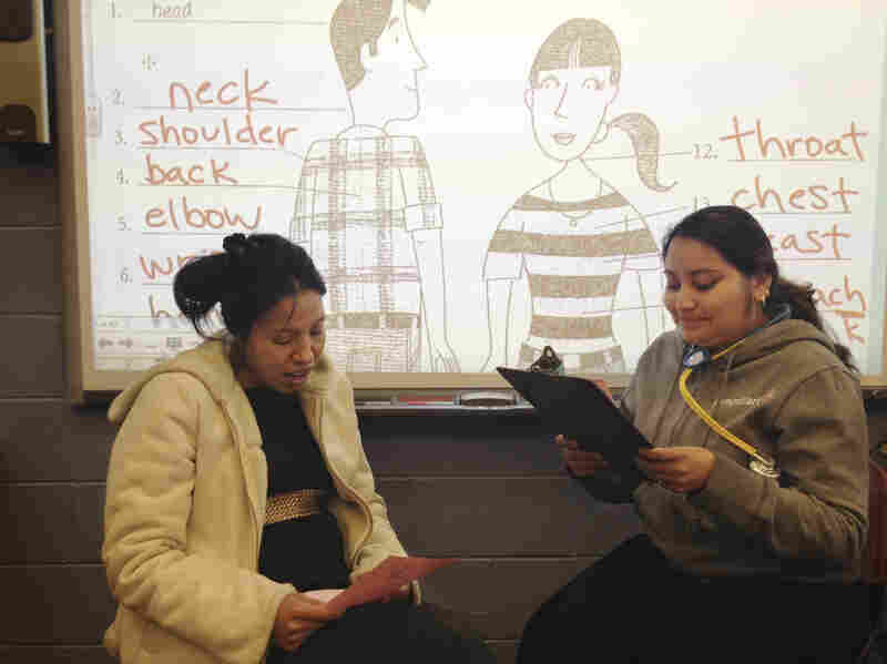 Students participate in a health literacy class at Mary's Center, role-playing a visit to the doctor.