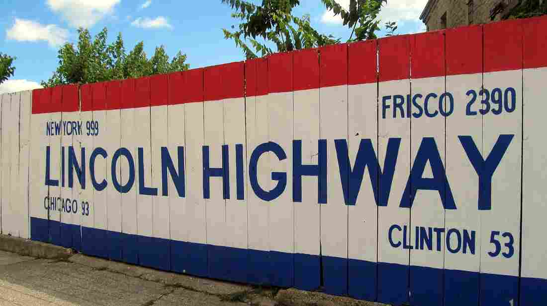 A large sign outside the Lincoln Highway Association headquarters in Franklin Grove, Ill., gives travelers a rough mileage to various spots along the route, including New York and San Francisco.