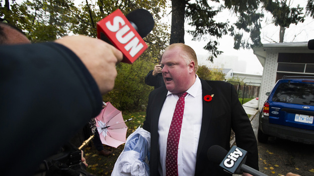When he emerged from his home Thursday morning, Toronto Mayor Rob Ford found reporters in his driveway. As they peppered him with questions, he shouted that they had to get out of his way. He didn't respond to questions about a video that allegedly shows him smoking crack. (Reuters /Landov)
