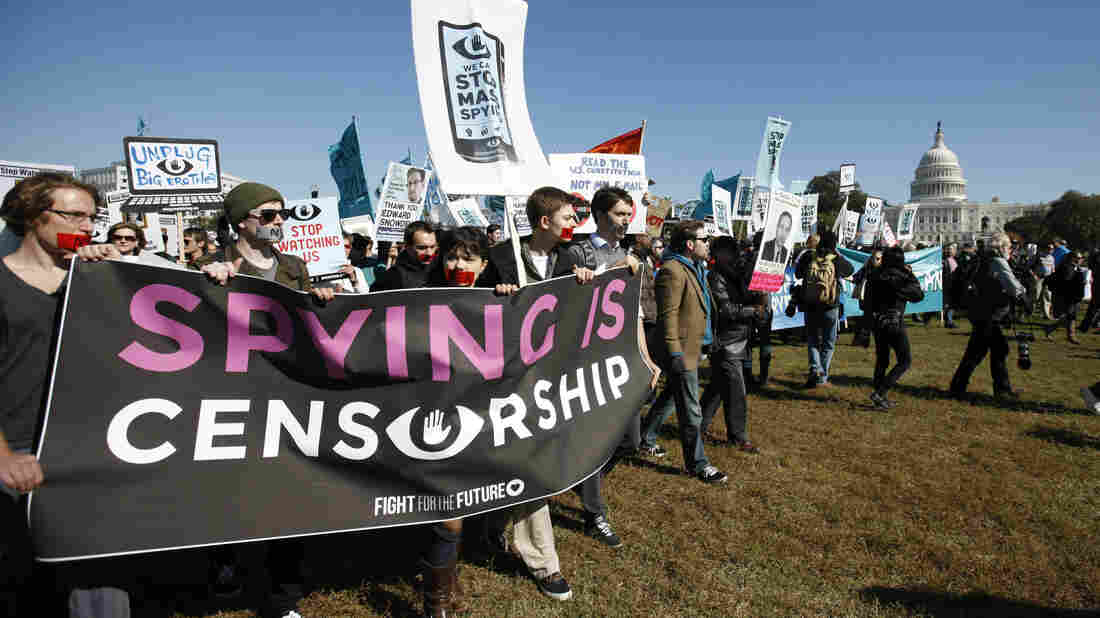 Demonstrators march toward the U.S. Capitol on Saturday to demand that Congress investigate the National Security Agency's mass surveillance programs.
