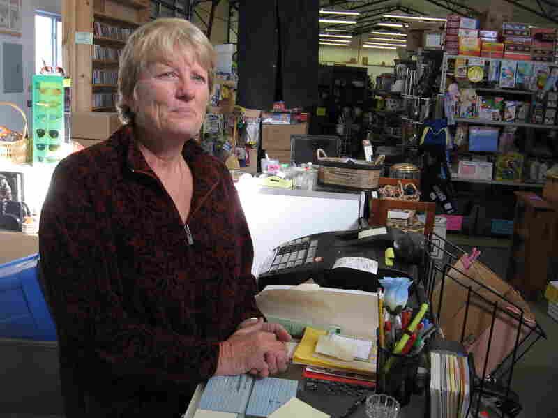 Lela Petersen, owner of the Anything And Everything store in Flagler, Colo., expects the cost of health insurance for her and her husband to drop by my more than half next year.