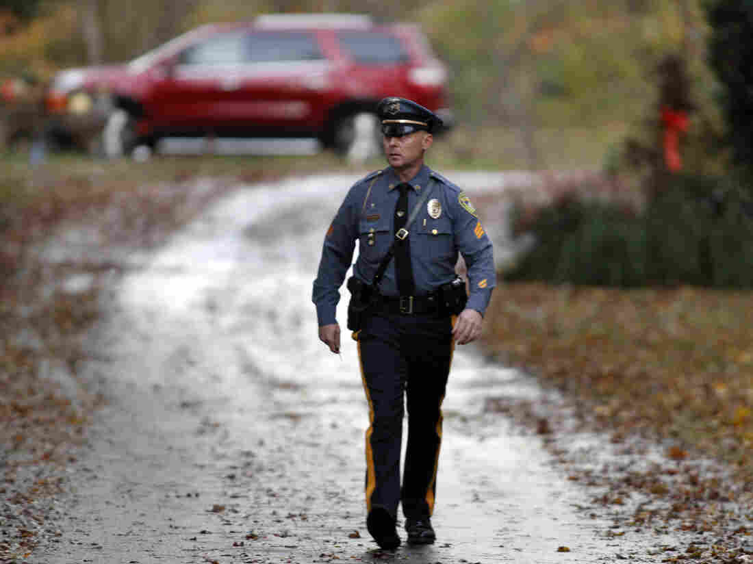 Police gather at a home belonging to the father of LA airport shooting suspect Paul Ciancia in Pennsville N.J. on Friday.