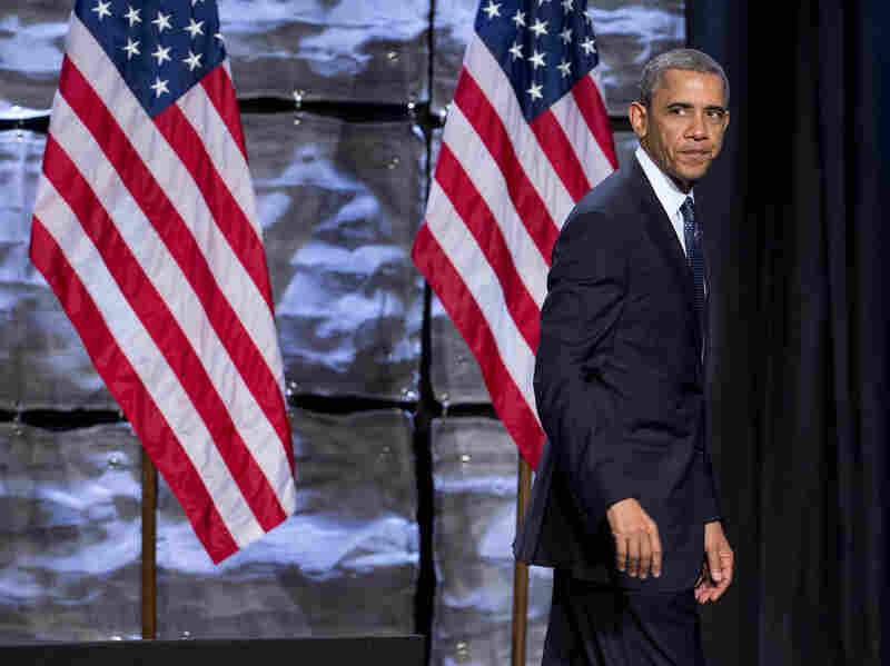 "President Obama walks off stage after speaking at the ""SelectUSA Investment Summit"" on Thursday. A poll released the same day found that the president's job approval rating had reached an all time low."