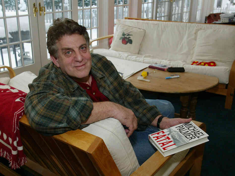 Michael Palmer poses at his home in Swampscott, Mass., in this 2002 photo.