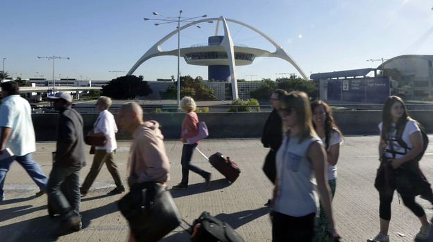 People exit Los Angeles International Airport in Los Angeles on Friday. (AP)