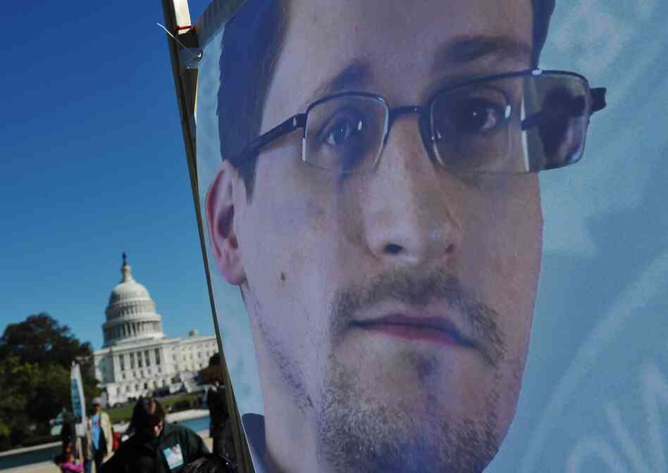 An image of Edward Snowden on the back of a banner is seen infront of the U.S. Capitol during a protest against government surveillance on October 26, 2013 in Washington, D.C.