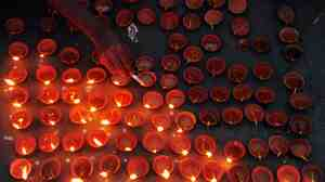 Little oil lamps mark Diwali celebrations in Allahabad, India, far away from American homes.
