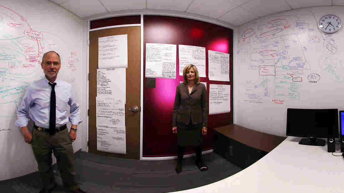In this panoramic composite image, NPR's Peter Overby and Viveca Novak of the Center for Responsive Politics stand in front of a whiteboard at NPR headquarters that they used to map out connections between social welfare groups.