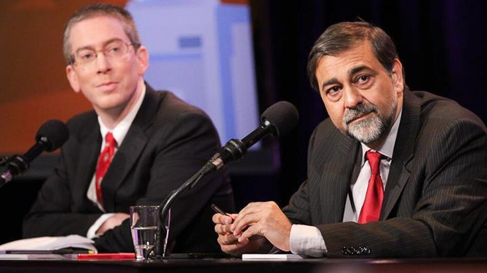 "Bryan Caplan (left) and Vivek Wadhwa argue in favor of the motion ""Let Anyone Take A Job Anywhere."""