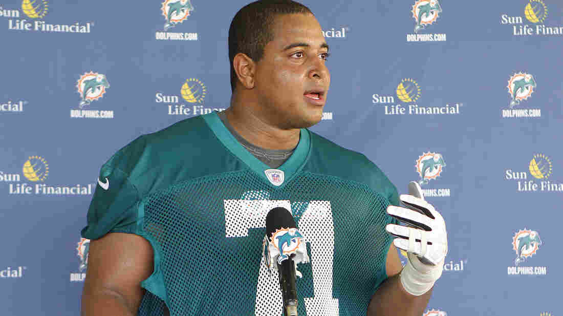 Jonathan Martin, seen here during an NFL rookies' camp in 2012, allegedly received threatening texts and voice mails from teammate Richie Incognito that included racial slurs.