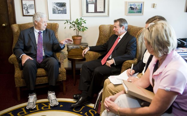 Rep. Michael Michaud, D-Maine, wears running shoes as he meets on Capitol Hill with New Balance CEO Robert DeMartini, July 18, 2012.