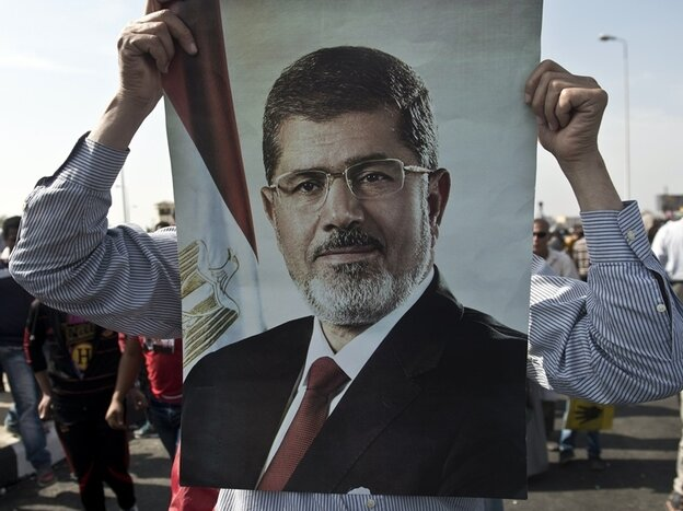 Supporters of ousted Egyptian President Mohammed Morsi rallied outside the police academy in Cairo where his trial was opened, and quickly adjourned, on Monday.
