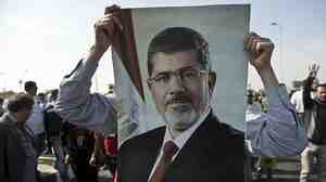Supporters of ousted Egyptian President Mohammed Morsi rallied outside the police academy in Cairo w