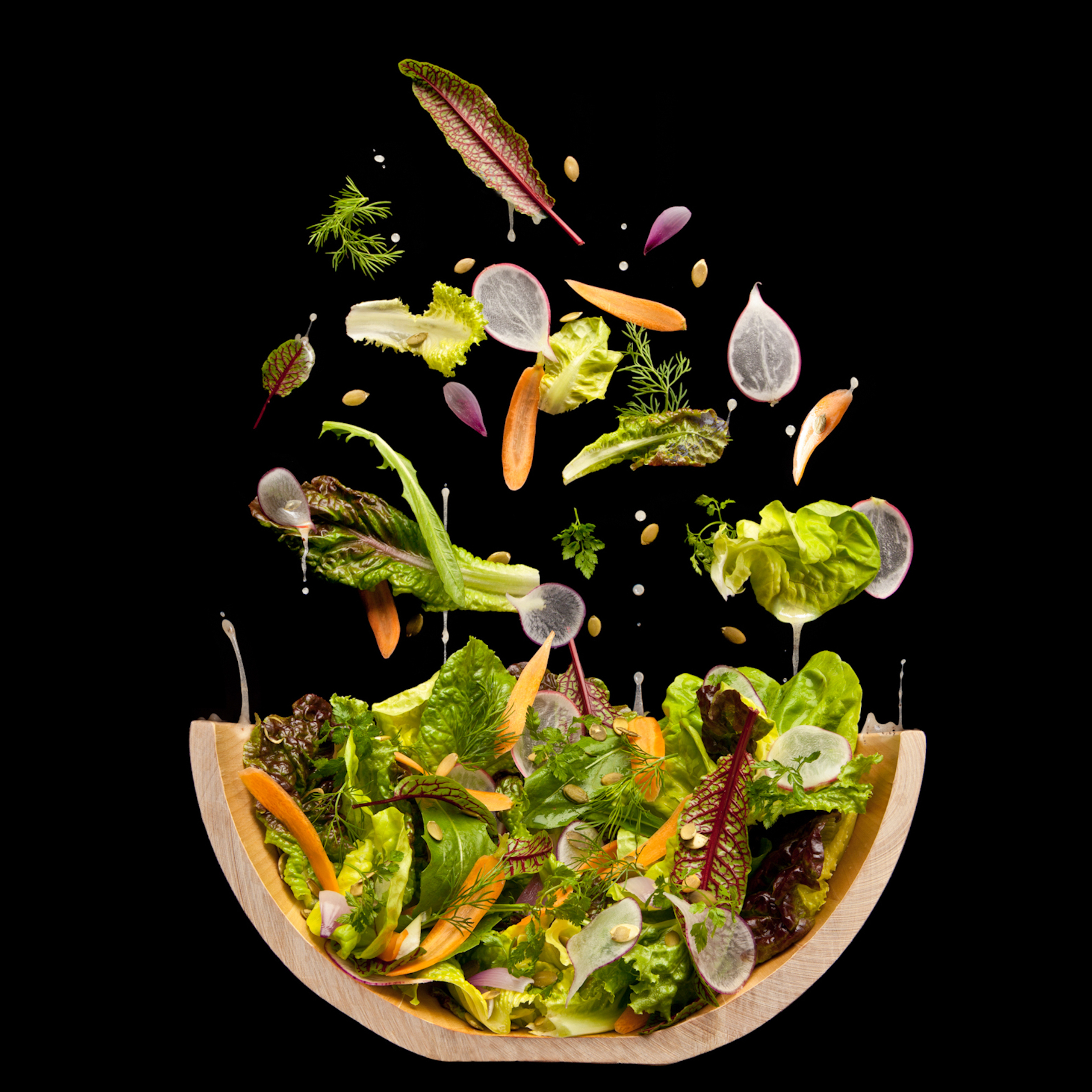 Caught in a toss: This image is actually dozens of photographs stitched together to recreate the moment when a salad mixes with its dressing.