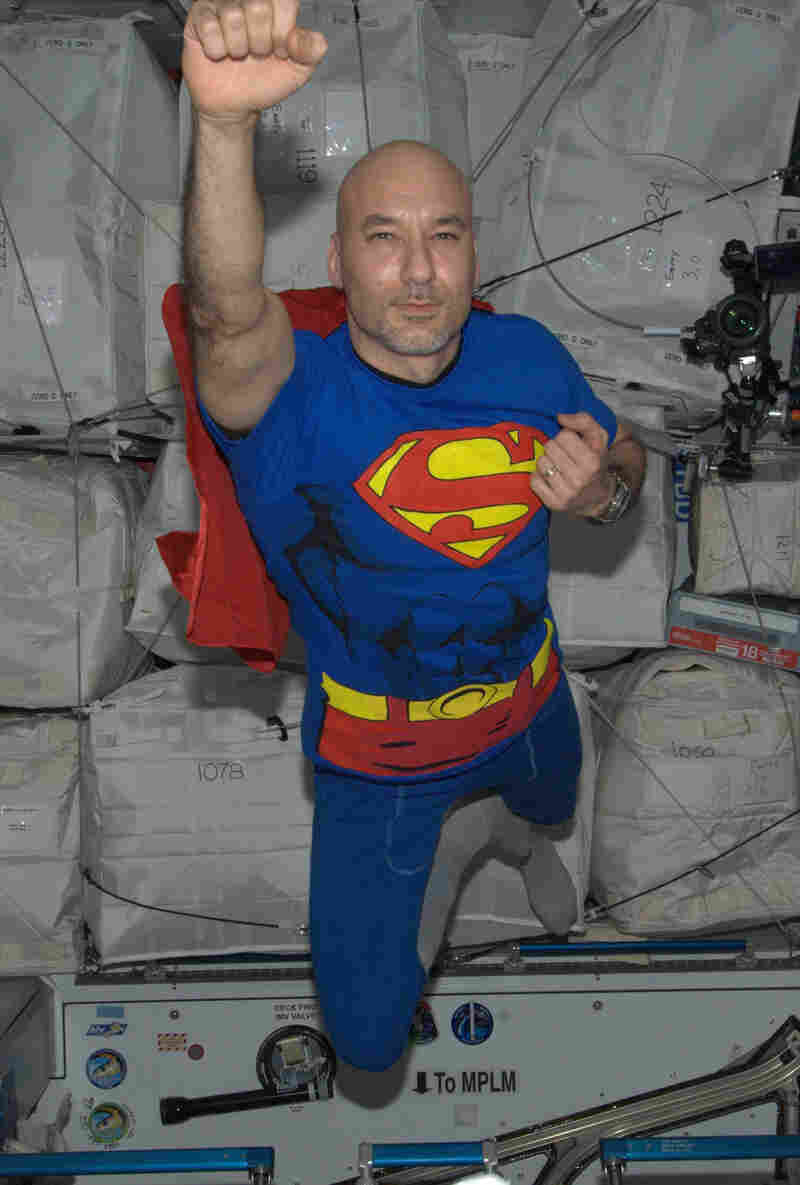Parmitano soaring through space as Superman on Halloween.