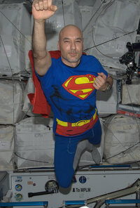 Parmitano soaring through space as Superman on Halloween.