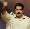 Yey Christmas: Venezuelan President Nicolas Maduro rises his clenched fist during a political meeting in Caracas, on August 7, 2013.