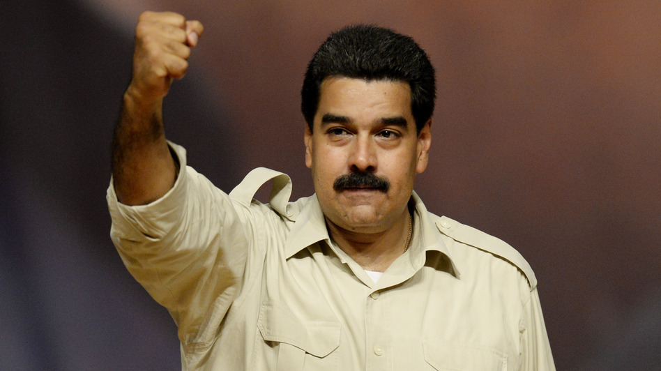 Yey Christmas: Venezuelan President Nicolas Maduro rises his clenched fist during a political meeting in Caracas, on August 7, 2013. (AFP/Getty Images)
