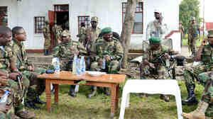 Leaders of the M23 rebel group gather near the eastern city of Goma, Democratic Republic of Congo, in June. The group, which recently suffered several military defeats, announced Tuesday it was calling off its nearly 2-year-old rebellion.