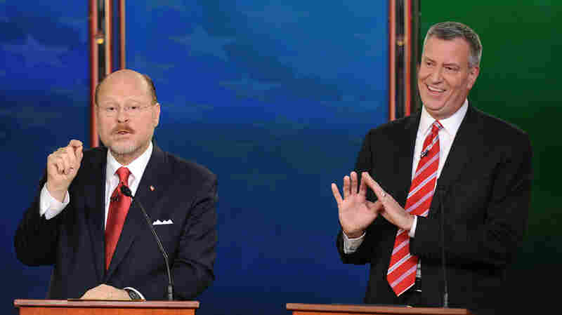 Republican Joe Lhota (left) makes a point during a debate with Bill de Blasio, his Democratic rival in the New York City mayor's race, on Oct. 30.