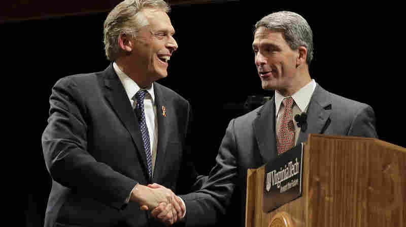 Democrat Terry McAuliffe (left) shakes the hand of Republican Ken Cuccinelli after a debate in the Virginia governor's race on Oct. 24.