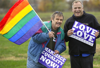 Jerry Bowman (left) and David Strzepek demonstrate at a marriage-equality rally in Springfield, Ill., on Monday.
