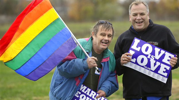 Jerry Bowman (left) and David Strzepek demonstrate at a marriage-equality rally in Springfield, Ill., on Monday. (AP)