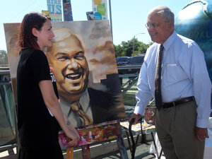 Sadia Bies and Boston Mayor Thomas Menino stand next to her portrait of him at a July press conference. Menino, the city's longest-serving mayor, is stepping down at the end of his term.