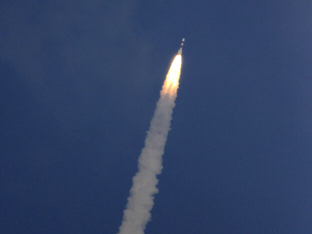 A rocket carrying the Mars orbiter lifts off from the island of Sriharikota, India, on Tuesday.