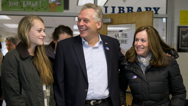 Virginia Democratic gubernatorial candidate Terry McAuliffe leaves Spring Hill Elementary School after voting, accompanied by his daughter Mary and wife Dorothy. (AP)