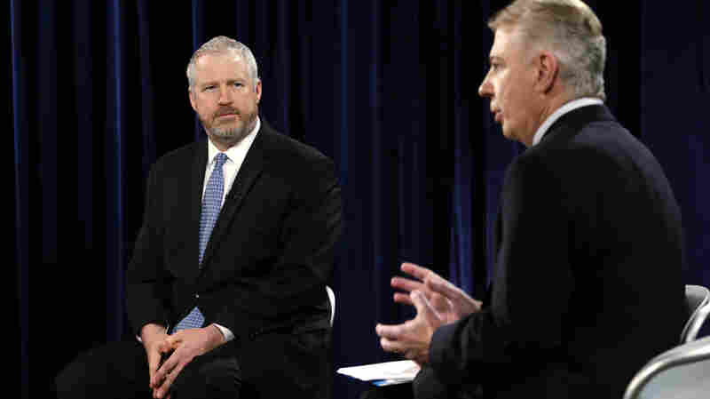 Seattle Mayor Mike McGinn (left) listens as state Sen. Ed Murray answers a question during a debate in their race for mayor on Oct. 9.