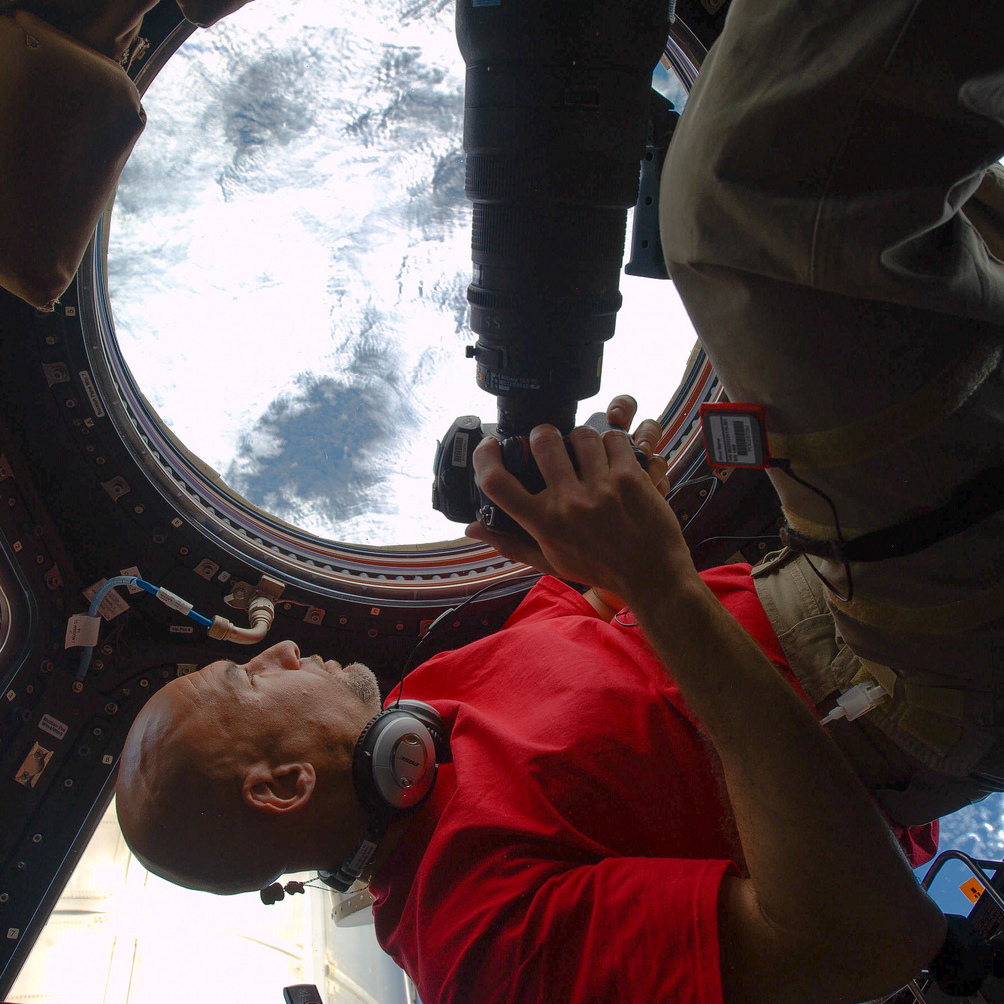 Astronaut Luca Parmitano with his camera inside the cupola on the International Space Station