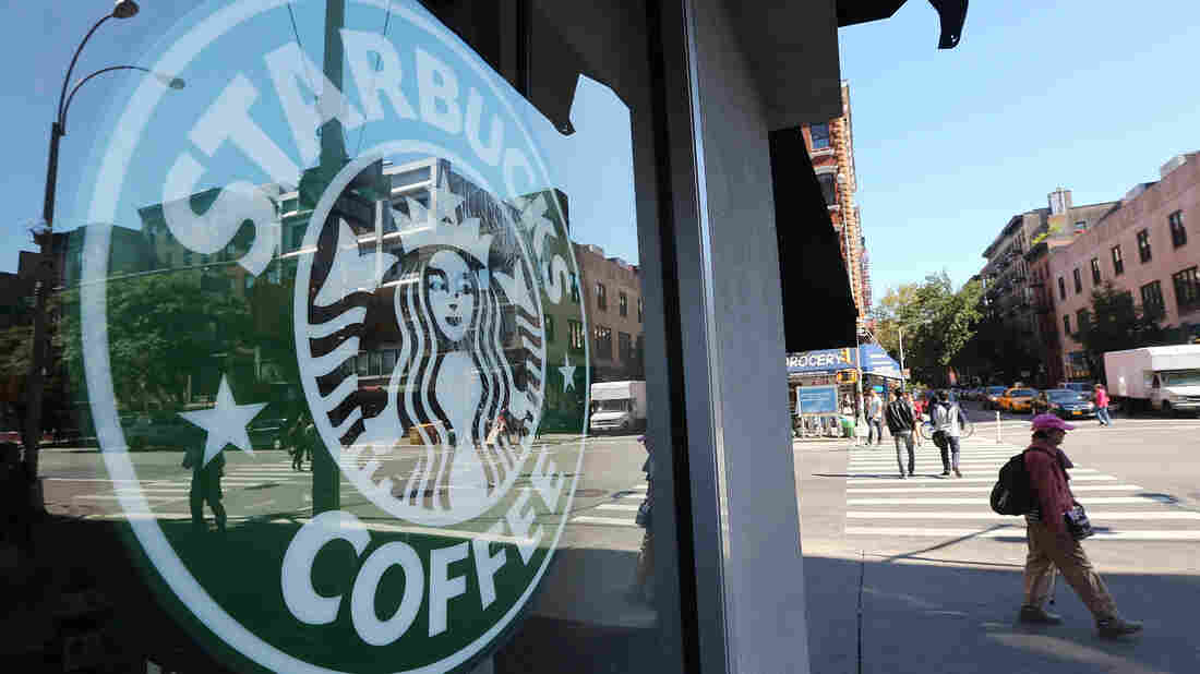 Seattle coffee giant Starbucks says the company will hire at least 10,000 veterans or their spouses over the next five years.