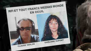 Photos of the two slain journalists in Paris on Sunday.