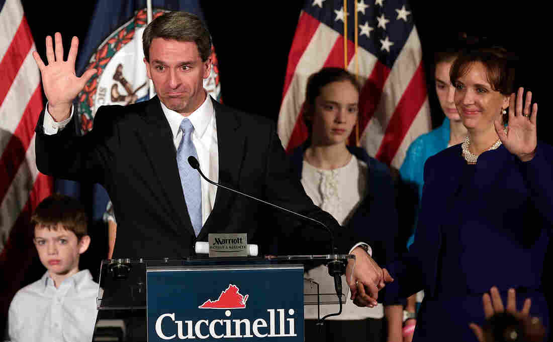 Virginia Attorney General Ken Cuccinelli, appearing with his family, waves goodbye to supporters after conceding the Virginia gov