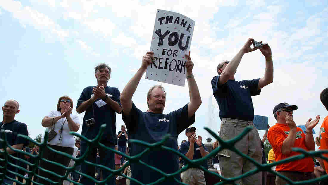 Union member Tom Stensberg holds a sign thanking Congress for the Affordable Care Act during a rally hosted by the AFL-CIO