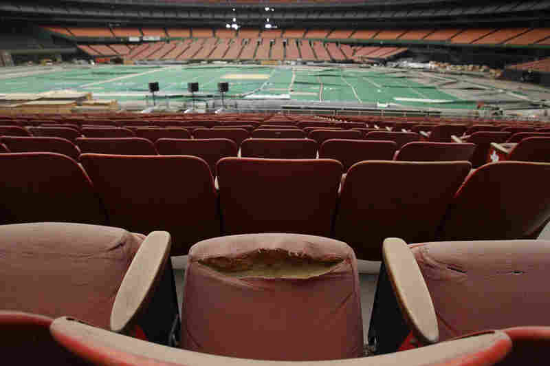 """Rows of dirty, tattered seats ring the Astrodome in Houston in 2012. Once touted as the """"Eighth Wonder of the World,"""" the nation's first domed stadium was last used in 2009."""