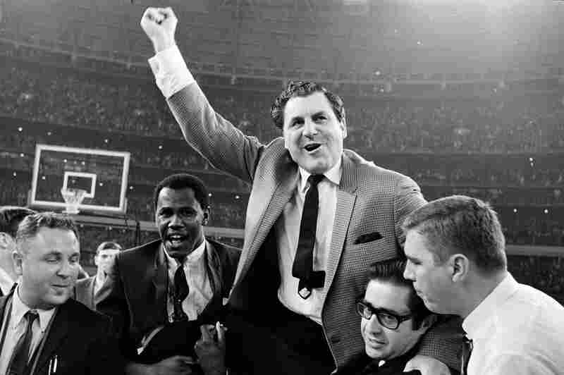 """Guy V. Lewis, University of Houston basketball coach, is carried to the dressing room by happy fans after the Cougars' upset win over UCLA in an NCAA college basketball game at the dome on Jan. 20, 1968. The game was known as college basketball's """"Game of the Century."""""""