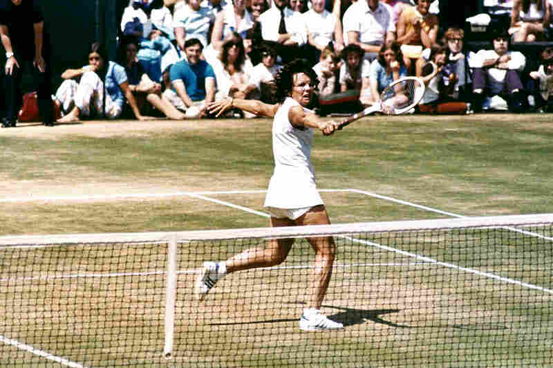 """Billie Jean King plays in the """"Battle of the Sexes"""""""" tennis match against Bobby Riggs on Sept. 20, 1973. King went on to beat Riggs in the highly watched match."""