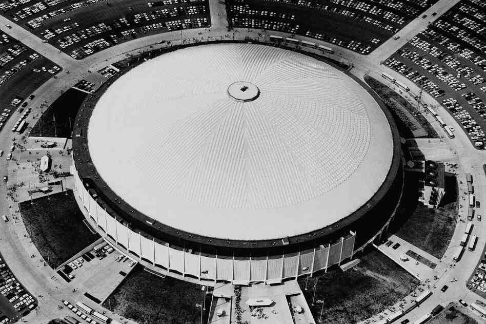 "View of the Astrodome from above in 1968. Earlier this year, The New York Times wrote that the Astrodome ""gave us domed, all-purpose stadiums and artificial turf and expansive scoreboards."" The dome went on to host a variety of sports events, large concerts and a politic"