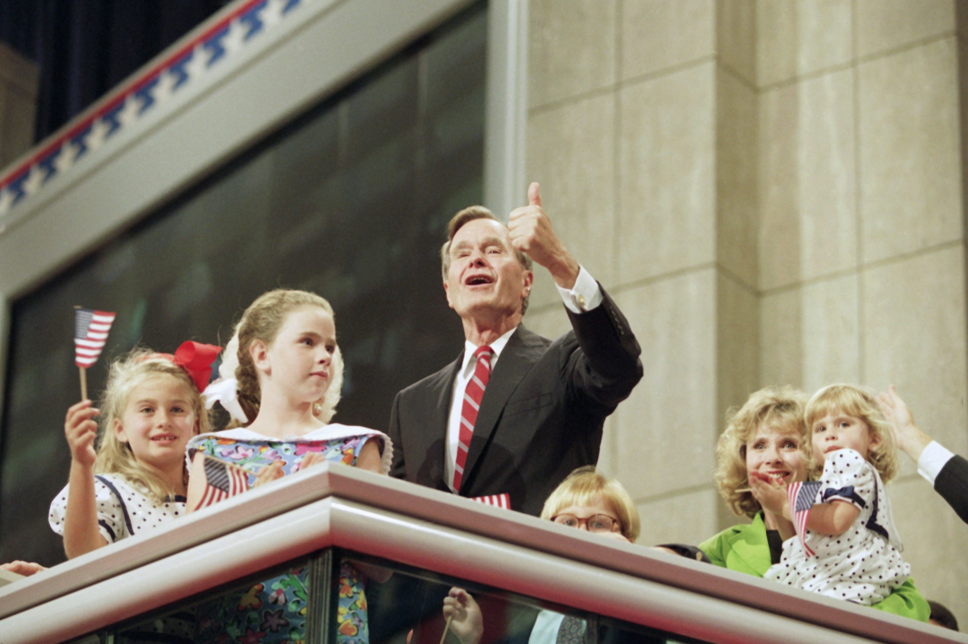 President George H.W. Bush addresses the crowd as he stands with his family on the podium at the Republican National Convention on Aug. 19, 1992.