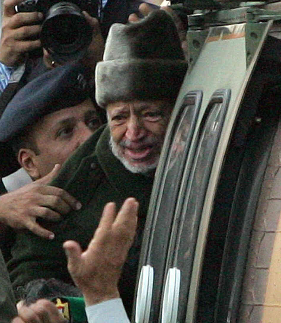 Oct. 29, 2004: Palestinian leader Yasser Arafat boards a helicopter in Ramallah, the West Bank, for the start of his journey to a hospital in France. He died 2 weeks la