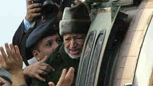 Oct. 29, 2004: Palestinian leader Yasser Arafat boards a helicopter in Ramallah, the West Bank, for the start of his journey to a hospital in France. He died 2 weeks later.