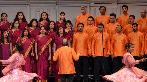 Kanniks Kannikeswaran leads the Greater Cincinnati Indian Community Choir in 2012, as it competes at the World Choir Games in Cincinnati.