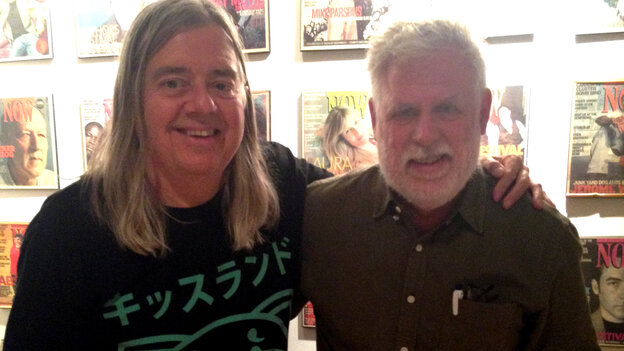Michael Hollett (left) with World Cafe host David Dye.