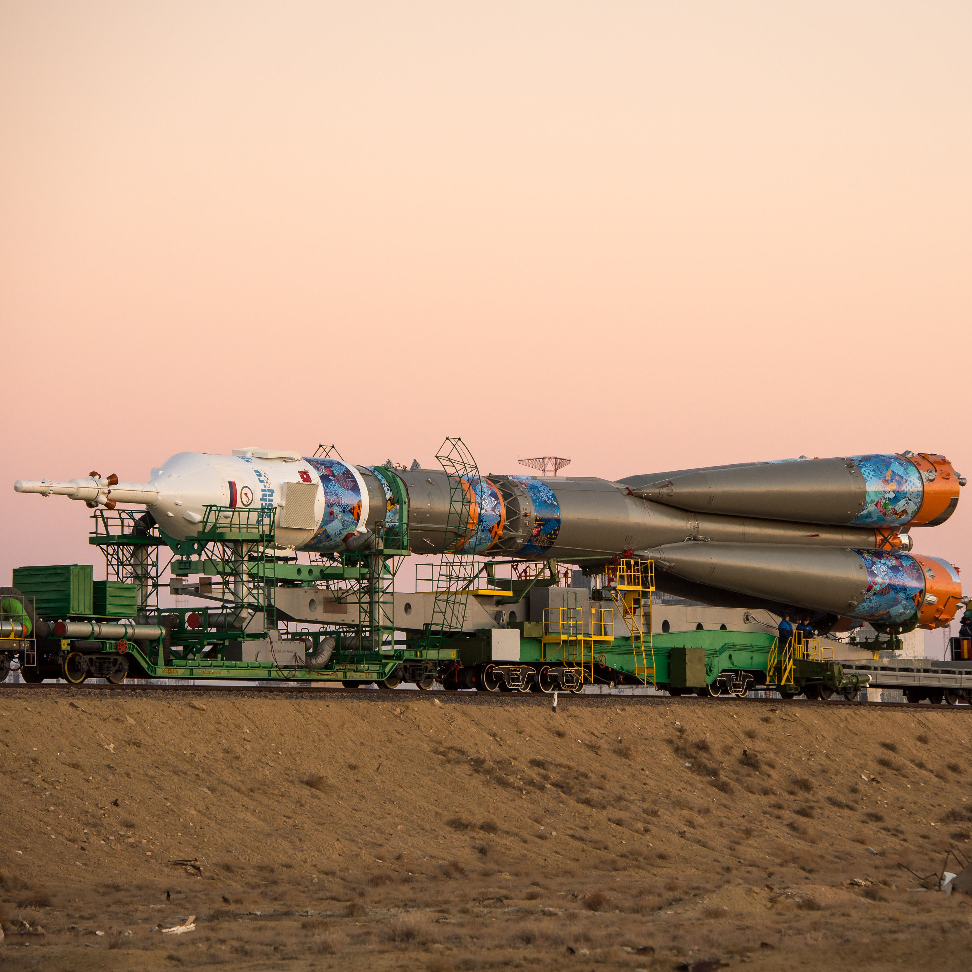 A Soyuz rocket, adorned with the logo of the Sochi Olympic Organizing Committee and other related artwork, is rolled out to the launch pad by train on Nov. 5, at the Baikonur Cosmodrome in Kazakhstan.
