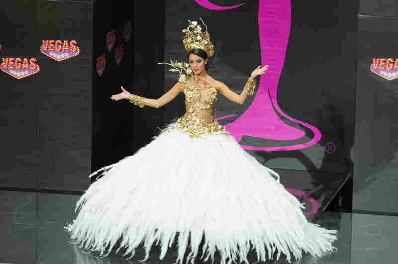 This photo of Brenda Gonzalez, Miss Argentina, is my prototype national costume. If you grew up wanting to be Miss Universe, this is why. Feathers, metallic bustier: this is it.