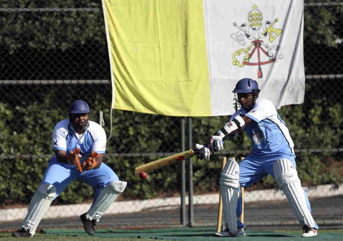 A player from the Vatican's new cricket team of priests and seminarians returns a ball during a training session at the Mater Ecclesiae Catholic college in Rome last month. The Vatican officially declared its intention to defeat the Church of England — not in a theological re-match nearly 500 years after they split, but on the cricket pitch.