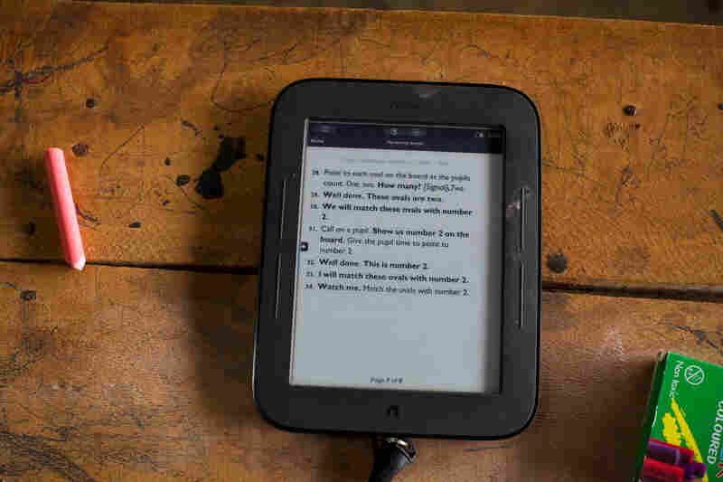 Every lesson is tightly scripted. The teachers deliver lessons by scrolling through the scripts on a tablet. Even small details such as praising students are listed in the class instructions.