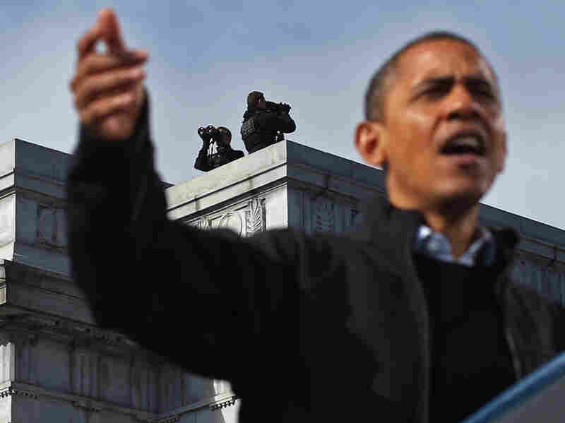 A Secret Service counter-sniper team looks out on the area as President Obama campaigns at a rally on Nov. 4, 2012, in Concord, N.H.